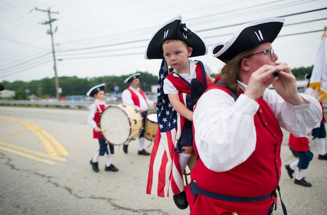 Therese Cuccia and her son Francis, 2, of Bethlehem, Connecticut participate in the Independence Day parade in Merrimack, New Hampshire July 4, 2015. (Photo by Gretchen Ertl/Reuters)