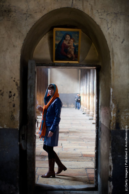 A Christian pilgrim walks through the Church of the Nativity in Bethlehem