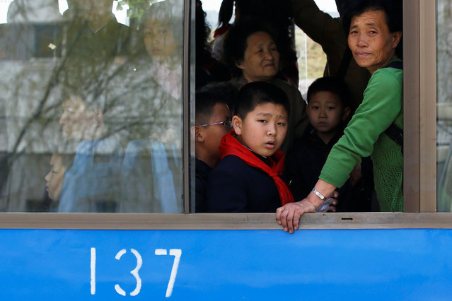 People look from inside a bus in central Pyongyang, North Korea April 16, 2017. (Photo by Damir Sagolj/Reuters)