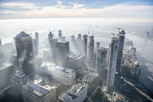 Dawn over Canary Wharf. (Photo by Jason Hawkes/Caters News Agency)