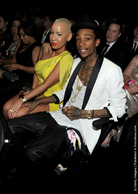Model Amber Rose (L) and rapper Wiz Khalifa attend the 54th Annual GRAMMY Awards held at Staples Center