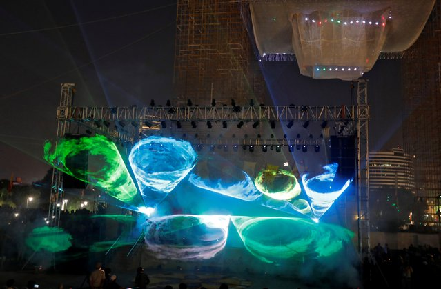A laser light show, organized by Delhi authorities to stop people from burning crackers, plays during Diwali, the Hindu festival of lights, celebrations at the Connaught Place in New Delhi, India, October 27, 2019. (Photo by Altaf Hussain/Reuters)