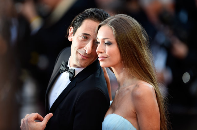 """Adrian Brody (L) and  Lara Lieto attend the """"Ismael's Ghosts (Les Fantomes d'Ismael)"""" screening and Opening Gala during the 70th annual Cannes Film Festival at Palais des Festivals on May 17, 2017 in Cannes, France. (Photo by Antony Jones/Getty Images)"""