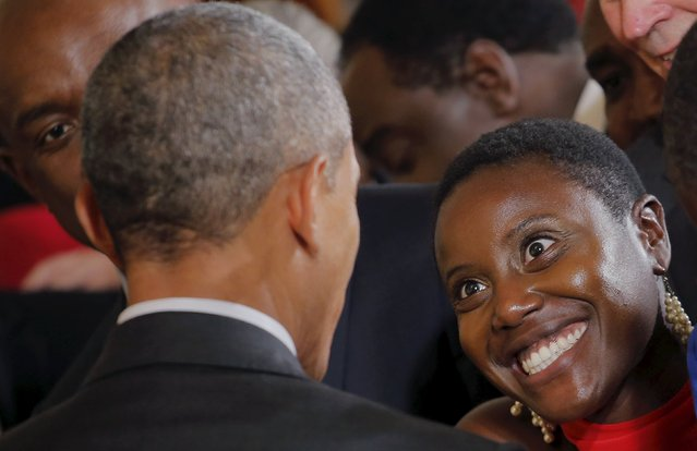 A guest smiles at U.S. President Barack Obama after the president delivered remarks at a reception celebrating the signing into law of the African Growth and Opportunity Act at the East Room of the White House in Washington July 22, 2015. (Photo by Carlos Barria/Reuters)