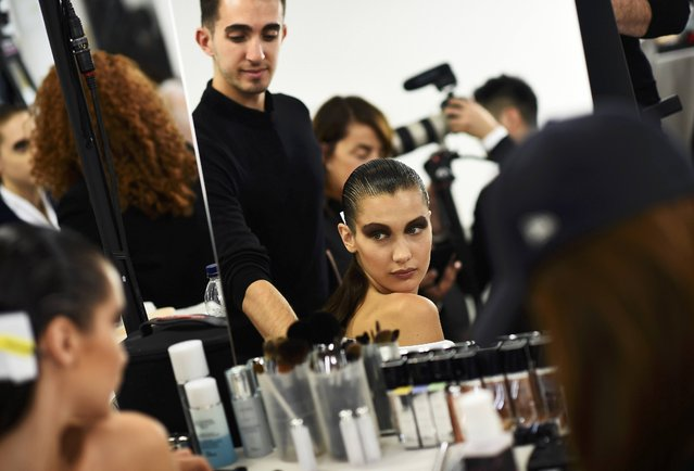 Model Bella Hadid has her make-up done inside Blenheim Palace ahead of a fashion show presenting the Dior, Cruise 2017 Collection, in Woodstock, Britain May 31, 2016. (Photo by Dylan Martinez/Reuters)