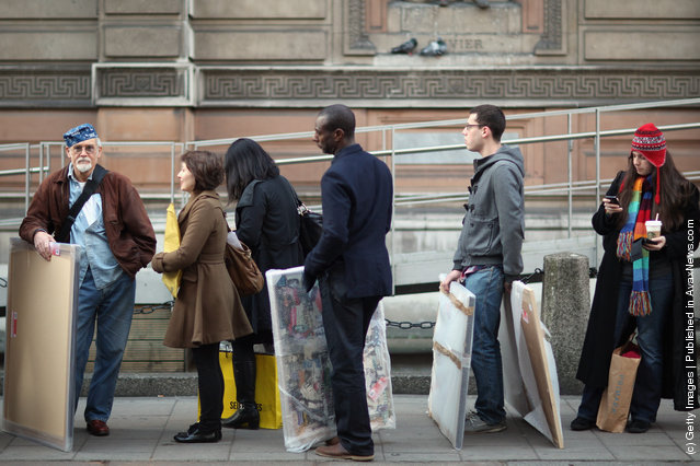 Artists arrive at The Royal Academy of Arts to hand in works completed for the 244th Summer Exhibition in London