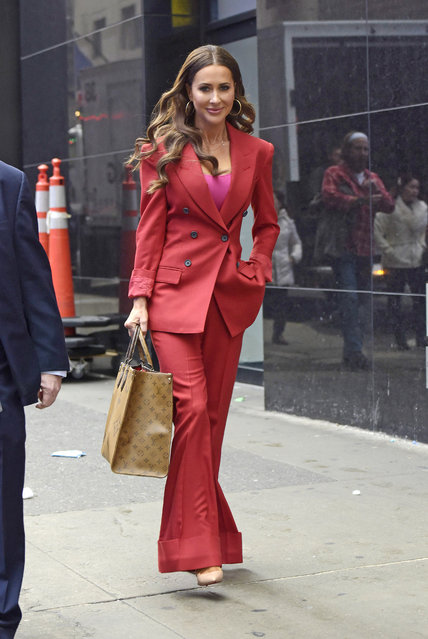 Canadian Fashion stylist Jessica Mulroney wears a carmine-colored pant suit and carries a Louis Vuitton leather handbag after appearing at Good Morning America in New York City, NY, USA on December 27, 2019. (Photo by Splash News and Pictures)