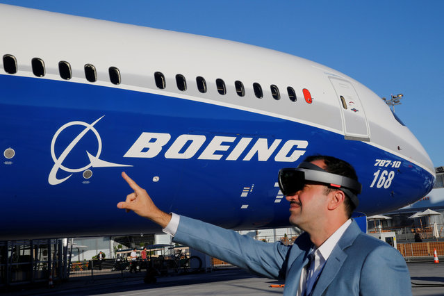 Maziar Farzam, President of Inhance Digital, demonstrates virtual reality glasses which provide digital information about the Boeing 787-10 aircraft, during the opening of the 52nd Paris Air Show at Le Bourget Airport, near Paris on June 19, 2017. (Photo by Pascal Rossignol/Reuters)