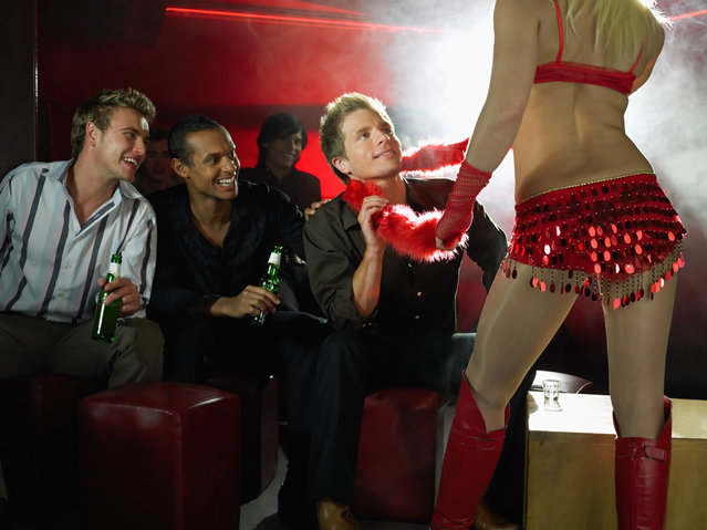 Men watching strip tease. (Photo by Image Source/Getty Images)