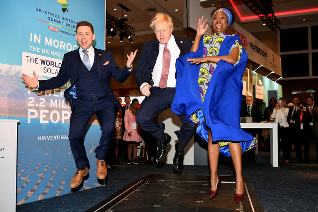 British Prime Minister Boris Johnson visits the Pavegen stand, a company that converts footsteps into energy, at the Innovation Zone during the UK-Africa Investment Summit in London, Britain on January 20, 2020. (Photo by Leon Neal/Pool via Reuters)