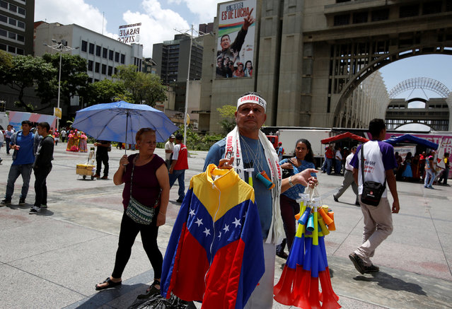 A street vendor sells a jacket in the colours of Venezuela's flag during a pro-government rally in Caracas, Venezuela, June 21, 2016. (Photo by Mariana Bazo/Reuters)