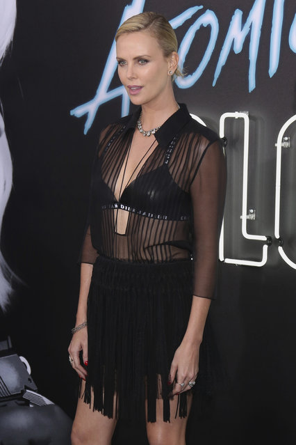 "Charlize Theron arrives at the LA Premiere of ""Atomic Blonde"" at The Theatre at Ace Hotel on Monday, July 24, 2017, in Los Angeles. (Photo by Willy Sanjuan/Invision/AP Photo)"