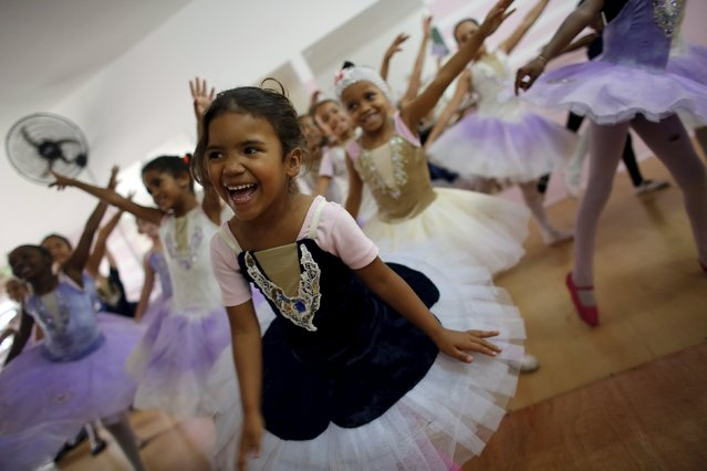 Young girls take ballet lessons at the New Dreams dance studio in the Luz neighborhood known to locals as Cracolandia (Crackland) in Sao Paulo, Brazil, August 14, 2015. (Photo by Nacho Doce/Reuters)