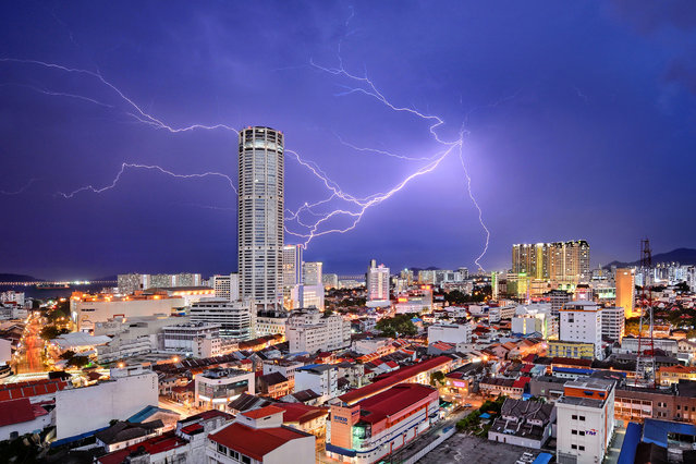 Cities, third place: Celestial Reverie. Lightning seemingly strikes Komtar Tower, the most iconic landmark of George Town, capital of Penang state in Malaysia. It is symbolic of the rejuvenation that the city, famous for a unique blend of centuries-old buildings and modern structures, has enjoyed in recent years. While many of its old neighbourhoods fell into neglect in the 1990s and early 2000s, a UNESCO World Heritage listing in 2008 sparked a transformation, and today, they are all part of a vibrant tourist destination. (Photo by Jeremy Tan/National Geographic Travel Photographer of the Year Contest)
