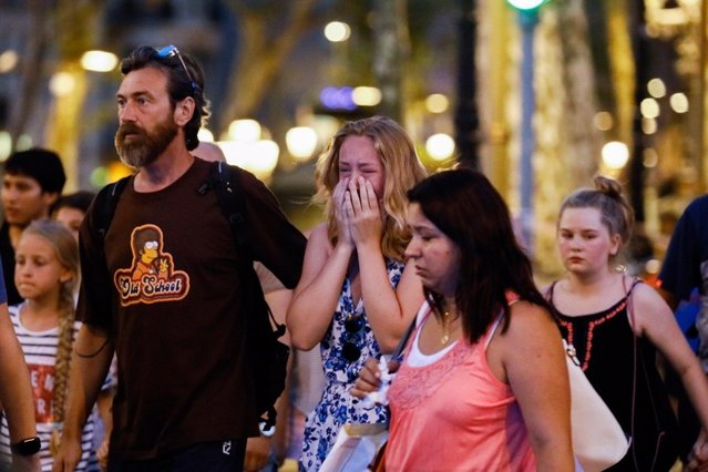 A woman cries at the area after a van plowed into the crowd, injuring several people in Barcelona, Spain on August 17, 2017. (Photo by Gorka Leiza/Anadolu Agency/Getty Images)