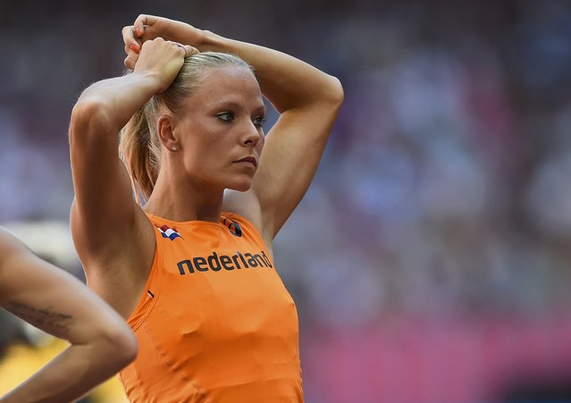 Nadine Broersen adjusts her hair before an attempt as she competes in the high jump event of the women's heptathlon during the 15th IAAF World Championships at the National Stadium in Beijing, China, August 22, 2015. (Photo by Dylan Martinez/Reuters)