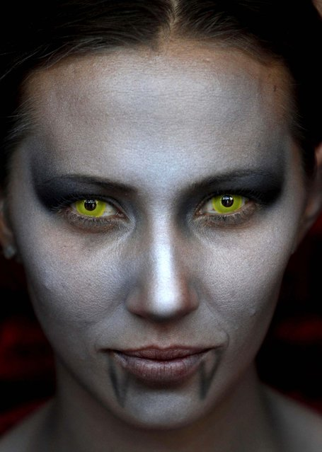 A woman is made up to look like a female vampire at the Comic-Con convention in Mexico City on July 21, 2012. (Photo by Marco Ugarte/Associated Press)