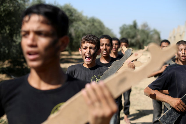 Young Palestinians take part in a military-style exercise during a summer camp organised by the Islamic Jihad Movement in Khan Younis in the southern Gaza Strip July 13, 2016. (Photo by Ibraheem Abu Mustafa/Reuters)