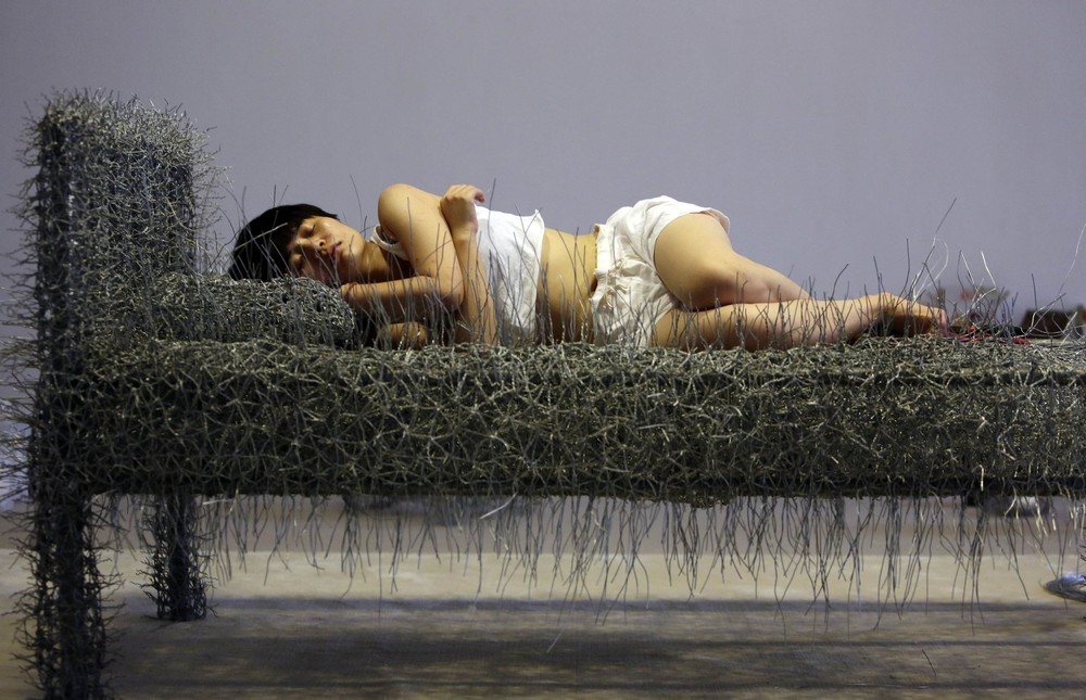 Chinese Artist Sleeps on a Iron Wire Bed