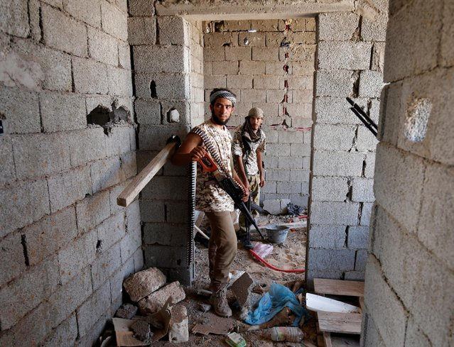 Fighters of Libyan forces allied with the U.N.-backed government stand in a house during a battle with IS fighters in Sirte, Libya, July 21, 2016. (Photo by Goran Tomasevic/Reuters)