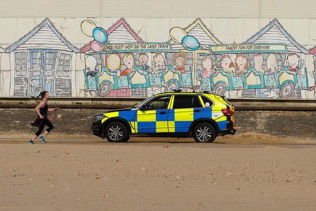 Police are seen on Bournemouth beach, as the spread of the coronavirus disease (COVID-19) continues, Bournemouth, Britain, April 5, 2020. (Photo by Matthew Childs/Reuters)