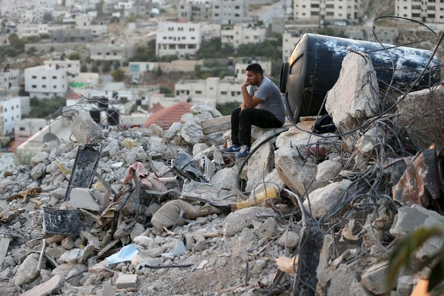 A Palestinian man sits atop the rubble of a house which was destroyed by Israeli troops during an Israeli raid in the West Bank city of Jenin September 1, 2015. At least five Palestinians and an Israeli soldier were wounded during an Israeli raid in the occupied West Bank late on Monday to arrest Islamist militants, Palestinian medical sources and Israeli media said. (Photo by Mohamad Torokman/Reuters)
