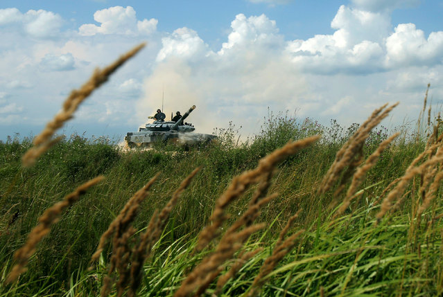 A T-72 tank, operated by a crew from Russia, drives during the Tank Biathlon competition, part of the International Army Games 2016, at a range in the settlement of Alabino outside Moscow, Russia, August 2, 2016. (Photo by Maxim Shemetov/Reuters)