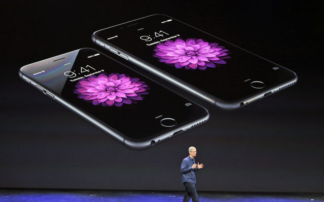 Apple CEO Tim Cook discusses the new iPhone 6 and iPhone 6 plus on Tuesday, September 9, 2014, in Cupertino, Calif. The iPhone 6 will have a screen measuring 4.7 inches, while the iPhone 6 Plus will be 5.5 inches. (Photo by Marcio Jose Sanchez/AP Photo)