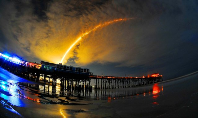 A Space X  Falcon 9 rocket carries the AsiaSat 6 mission for the United State Air Force, from the Cape Canaveral Air Force Station; in the foreground is the Cocoa Beach Pier, on September 7, 2014. (Photo by Craig Rubadoux/Florida Today)
