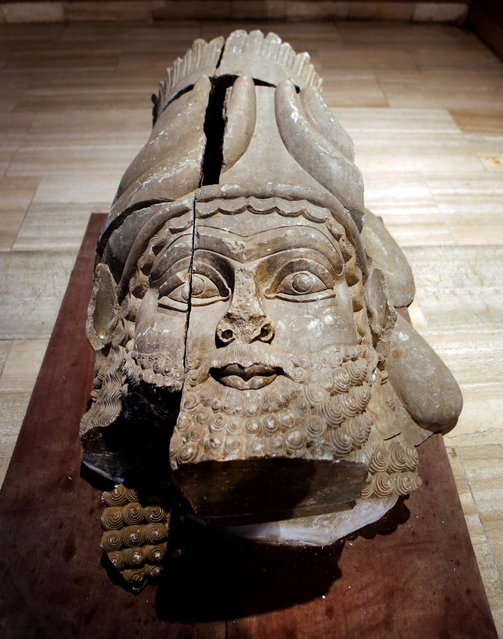 This Monday, September 15, 2014 photo shows the head of a winged bull made out of limestone restored and displayed at the Iraqi National Museum in Baghdad. Now much of that archaeological wealth is under the control of extremists from the Islamic State group. They have already destroyed some of that heritage in their zealotry to uproot what they see as heresy. (Photo by Hadi Mizban/AP Photo)
