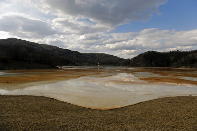 A polluted lake, tainted with cyanide and other chemicals, is seen covering Geamana village near Rosia Montana, central Romania, March 24, 2014. (Photo by Bogdan Cristel/Reuters)