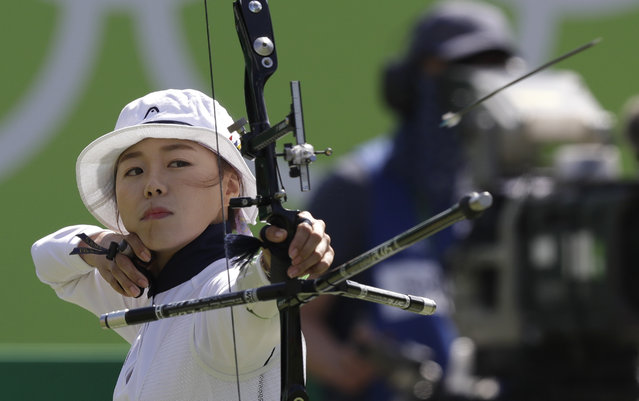 South Korea's Chang Hye-jin, releases her arrow during an elimination round of the individual archery competition at the Sambadrome venue during the 2016 Summer Olympics in Rio de Janeiro, Brazil, Thursday, August 11, 2016. (Photo by Alessandra Tarantino/AP Photo)