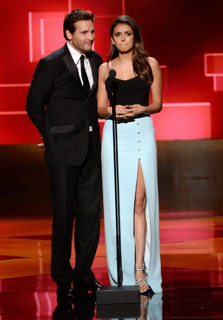 Peter Facinelli, left, and Nina Dobrev present the award for outstanding picture editing for reality programming at the Television Academy's Creative Arts Emmy Awards at Microsoft Theater on Saturday, September 12, 2015, in Los Angeles. (Photo by Phil McCarten/Invision for the Television Academy/AP Images)