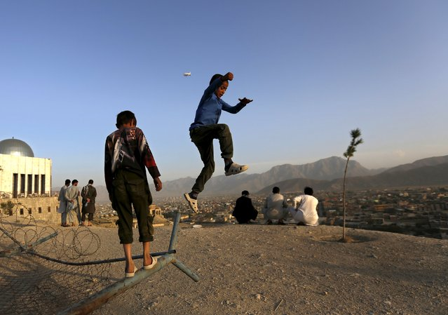 Boys play on a hilltop in Kabul, Afghanistan September 3, 2015. (Photo by Mohammad Ismail/Reuters)