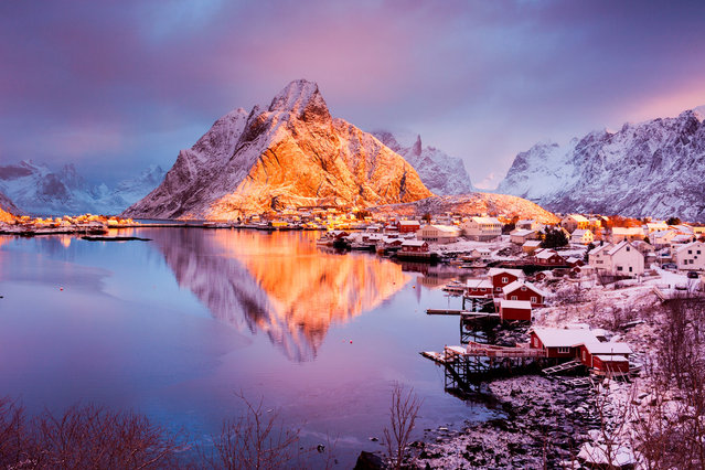 Reine, Lofoten, Norway. Lots of windy days and nights during our trip, but on this particular morning, we were extremely lucky to have freshly fallen snow and little wind. A few minutes after this shot was taken, the clouds and fog enveloped the area, blocking the sun, but leaving behind more beautiful snow. (Photo by Vicki Mar/Getty Images)
