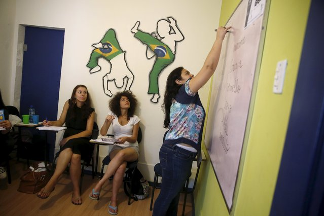 Tulin Hashemi (C), a Syrian, attends a Portuguese lesson at the Caminhos Language Centre in Rio de Janeiro, Brazil, September 22, 2015. (Photo by Pilar Olivares/Reuters)