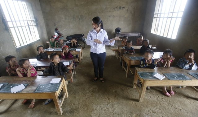 Giang Thi May teaches a first grade class at the primary school of Van Chai in Dong Van district, on the border with China, north of Hanoi, Vietnam, September 21, 2015. There is no electricity and no books. She teaches the children in the local Hmong language. (Photo by Reuters/Kham)