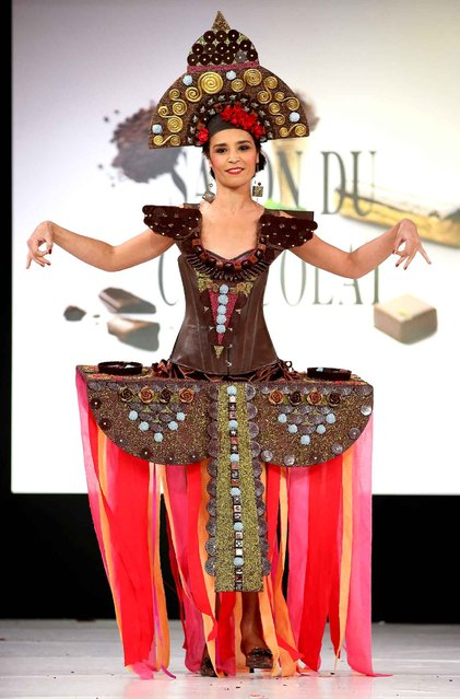 Aida Touihri walks the runway and wears a chocolate costume made by designer and a chocolate maker during the Fashion Chocolate show at Salon du Chocolat at Parc des Expositions Porte de Versailles in Paris, France, October 28, 2014. (Photo by LAURENTVU/SIPA Press)
