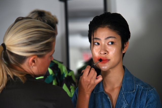 A model prepares backstage at the VFILES fashion show during New York Fashion Week at Spring Studios on September 7, 2016 in New York City. (Photo by Ben Gabbe/Getty Images)