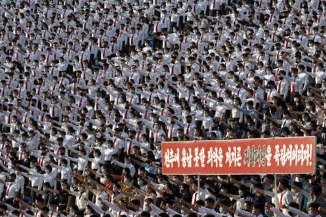 North Korean students stage a rally to denounce South Korea following that defectors and other activists in South Korea flew anti-Pyongyang leaflets over the border, at the Pyongyang Youth Park Open-air Theatre in Pyongyang, Saturday, June 6, 2020. The letters say: Let us smash the puppet regime that committed indelible crime. (Photo by Jon Chol Jin/AP Photo)