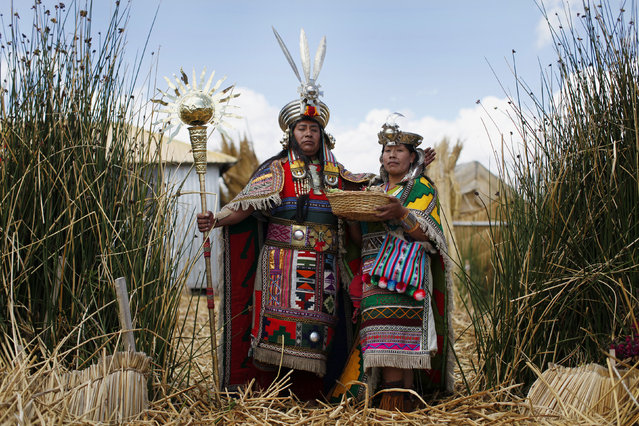 An Andean man and a woman, depicting Inca's legendary characters Manco Capac and Mama Ocllo, pose for a portrait in a Uros island at Lake Titicaca before a re-enactment in Puno November 5, 2014. The Uros islands are a group of 70 man-made totora reed islands floating on the lake, which according to Peru's tourism board iPeru is the world's highest navigable lake at over 4,000 meters above sea level. (Photo by Enrique Castro-Mendivil/Reuters)