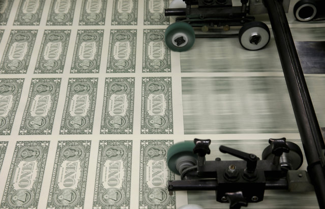 Sheets of one dollar bills are seen during the production process at the Bureau of Engraving and Printing in Washington November 14, 2014. (Photo by Gary Cameron/Reuters)
