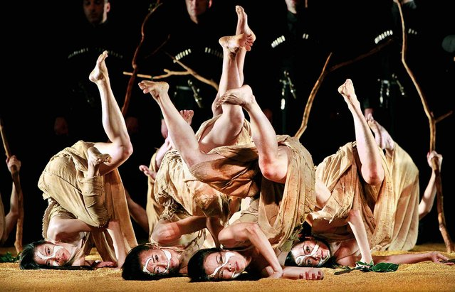 "Members of Taiwan's Cloud Gate Dance Theater perform its renowned work ""Songs of the Wanderers"" during a rehearsal in Taipei, Taiwan, on February 20, 2013. (Photo by Wally Santana/Associated Press)"