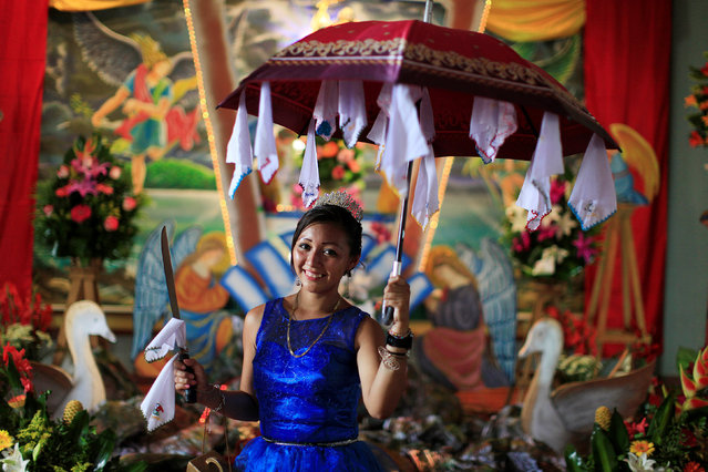 A participant in the traditional dance of Los Historiantes poses for a photo during festivities in honour of St. Michael the Archangel in San Miguel Tepezontes, El Salvador September 28, 2016. (Photo by Jose Cabezas/Reuters)