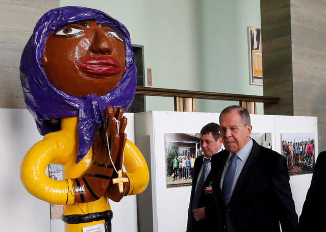 Sergey Lavrov, Minister for Foreign Affairs of Russia, walks past a statue in an exhibition hall outside the Human Rights Council conference hall, at the United Nations in Geneva, Switzerland, February 28, 2018. (Photo by Denis Balibouse/Reuters)
