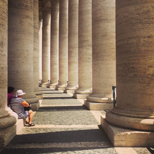 "Runner-up. ""This was taken in the piazza of Saint Peter's, Vatican City, Rome. As we walked in awe around the square, this June, the quiet resting of these fellow visitors bought a moment of calm in the shadows. MICK RYAN, JUDGE: A holiday snap? Maybe. But a great one. Repeating patterns are always compelling but more so here with the surreptitiously caught resting couple breaking up the columns. Beautifully composed and I like the 1970s-style Kodak look too"". (Photo by Esther Metcalf/The Guardian)"
