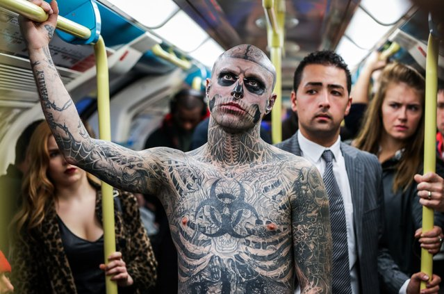 Zombie Boy, who holds a Guinness World Record for most bones inked on a human body, gave Londoners a fright on October 5, 2016 as he was spotted at commuter hotspots across the capital to promote Thorpe Park's new Halloween attraction. Canadian born Zombie Boy has 90% of his body covered in tattoos with a value of over $20,000 in total, including an entire skeleton and skull on his face, visited Canary Wharf, Oxford Street and Soho. (Photo by Rex Features)