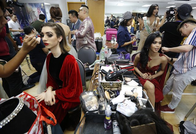 Contestants prepare backstage during the annual transgender beauty contest of Miss International Queen 2018 at Pattaya city, in Chonburi province, Thailand, 09 March 2018. (Photo by Narong Sangnak/EPA/EFE)