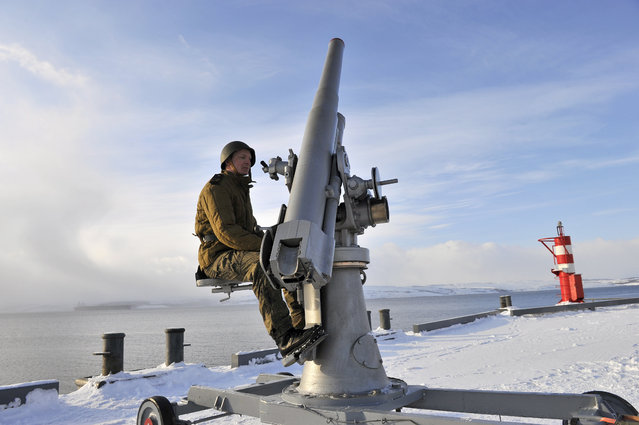 Russia' s Northern Fleet serviceman test firing a 76- mm air- defense gun M1914 discovered near the Novaya Zemlya Archipelago, Murmansk, Russia on March 19, 2018. The 76- mm air- defense gun M1914/15, the first Russian anti- aircraft gun, remained in production until 1934. (Photo by Lev Fedoseyev/TASS/Barcroft Images)