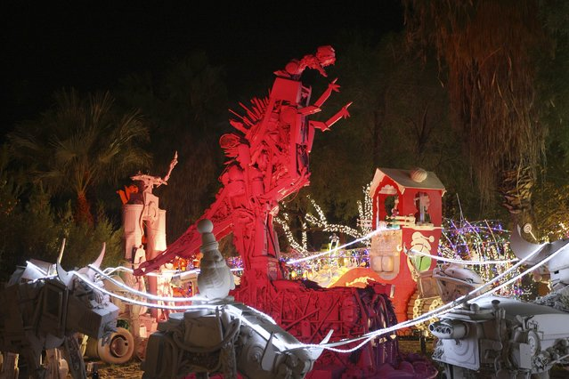 Reindeer sculptures encircle a dinosaur-like robot character at the Robolights art installation by Kenny Irwin Jr. in Palm Springs, California December 15, 2014. (Photo by David McNew/Reuters)